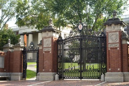 Brown University's iconic Van Wickle Gates swing open only twice per year: Freshmen walk in on the first day of classes, Seniors process out during Commencement.