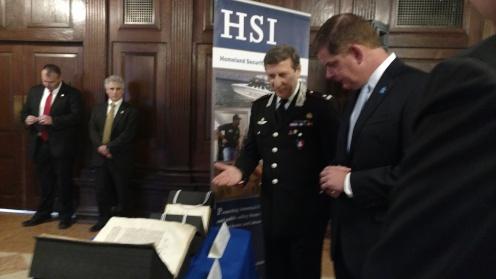 Boston Mayor Marty Walsh examining the Mariegola with a representative of the Italian government